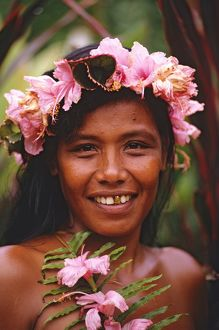 Portrait of woman with hibiscus flowers in her hair,