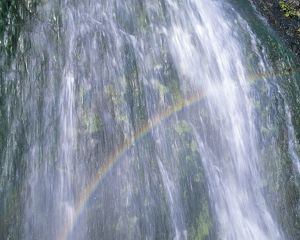 Rainbow over waterfall,