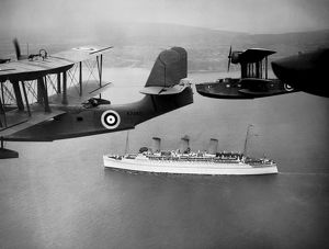 RMS Empress of Britain being escorted by Royal Air Force flying boats
