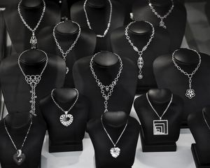 Silver necklaces in jewellery shop,