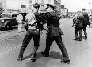 Striking worker being arrested on the streets of San Francisco in 1934