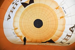 Technician preparing hot air balloon for flight,