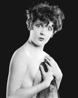 Vintage portrait of nude woman looking surprised
