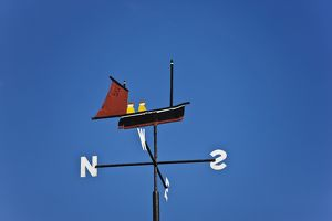Weathervane in the shape of a boat with two sailors,