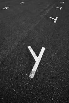 A white painted letter Y on the road surface of a carpark,