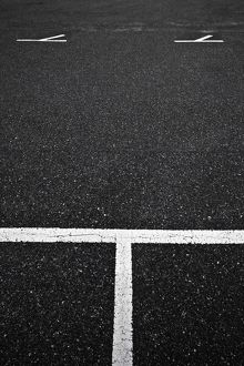 White painted markings in a carpark,