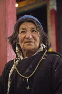 Woman villager of Tibetan-culture in festive clothes