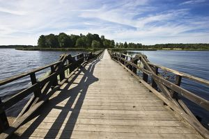 Wooden bridge across lake at Frovi,
