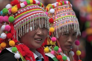 Two young woman dancers of the Lisu minority people wearing traditional headdresses