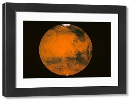 Image of Mars, the Red Planet. showing North and South Poles. Image from the Hubble Space Telescope