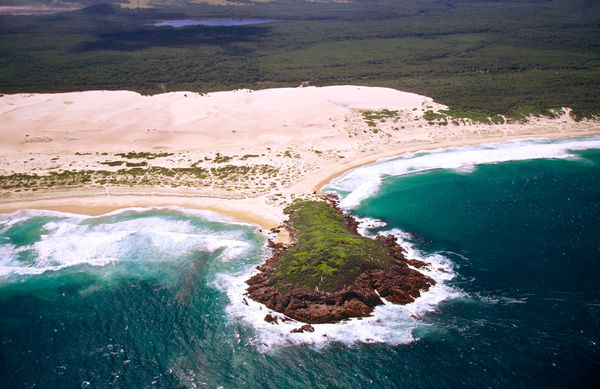 Dark Point headland, from the air, showing the giant dunes behind. Dark Point is a declared Aboriginal Place; its significance is its occupation by the Worimi people. Myall Lakes National Park, New South Wales, Australia