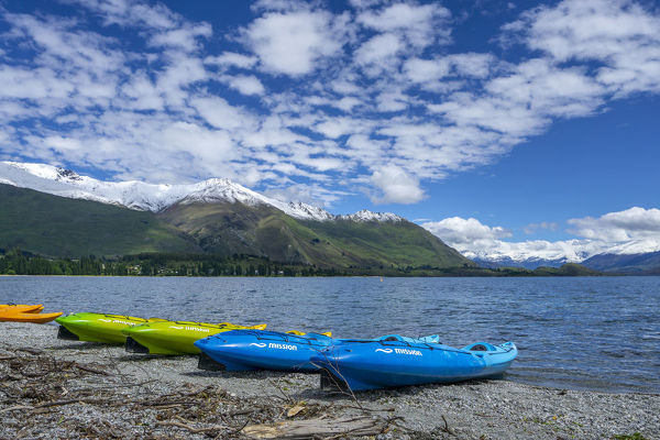 Kayaks on the shore of Lake Wanaka, a popular tourist destination at the heart of the Otago Lakes. Wanaka township is the gateway to Mount Aspiring National Park. Otago, New Zealand