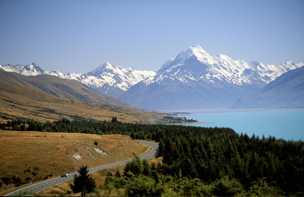 Lake Pukaki with Mount Cook/Aoraki beyond. The lake is a moraine-dammed lake created when terminal moraines of receding glaciers block the valley, forming a dam. South Island, New Zealand