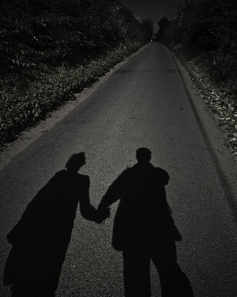 Shadows of two people hand in hand walking along a road 343adfb307