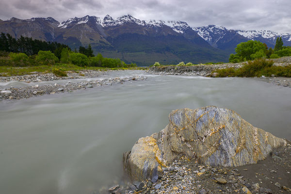 Snow-fed stream flowing into Lake Wakatipu at its northern tip. Glenorchy, Otago, South Island, New Zealand