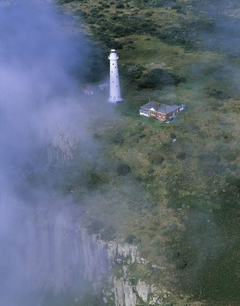 Tasman Island and lighthouse, aerial photograph. Tasman National Park, Tasmania, Australia
