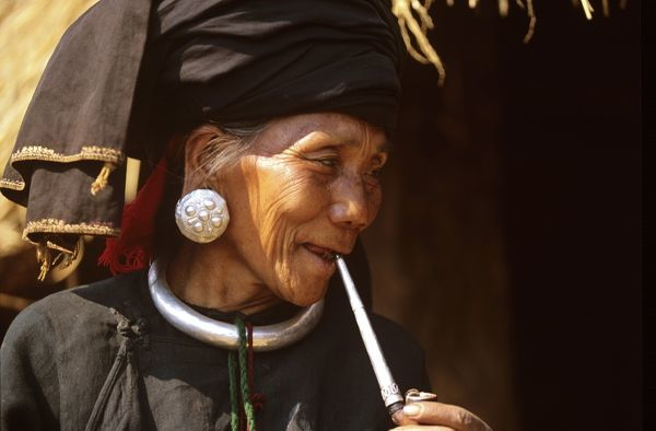 Woman of Awa minority smoking a pipe