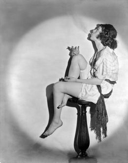vintage historical/1922 portrait young woman seated pedestal smoking