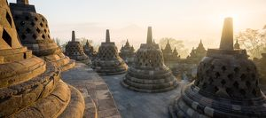 Borobudur at dawn and some of the 72 openwork stupas each containing an image of
