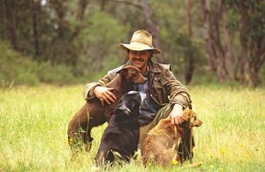 Cattleman with his working dogs,