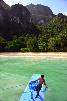 Crew member on the prow of a traditional Palawan boat