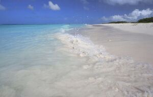 Deserted white sand beach and clear azure sea