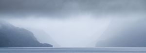 Doubtful Sound under low cloud and rain.