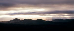 Dusk over mountains with crepuscular rays,