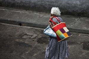 Elderly Seychellois woman with shopping bag,