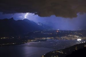 Fireworks competing with lightning over Thun city and lake