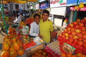 Two friends at their fruit stall