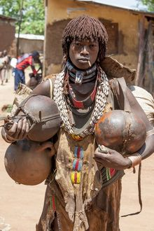 Hamar tribeswoman carrying gourds