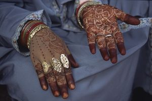 Henna-painted hands of a young married Muslim woman,