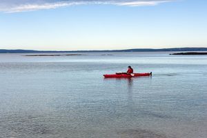 Kayaker in Jervis Bay in the early morning