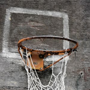 Rusty basketball ring with net