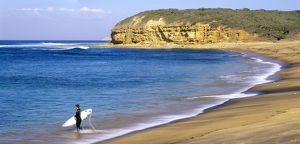 Surfer on Bells Beach, one of Australia's most famous surfing beaches,