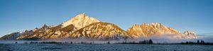 The Teton Range from the southwest over frosted grassland and mist rising from the